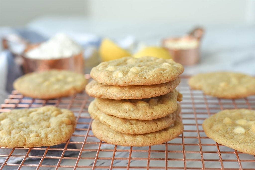 stack of Lemon White Chocolate Chip cookies on cooling rack
