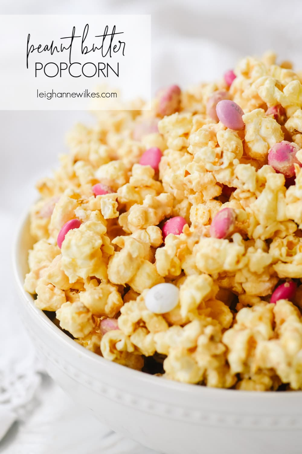 bowl of peanut butter popcorn with M & M's