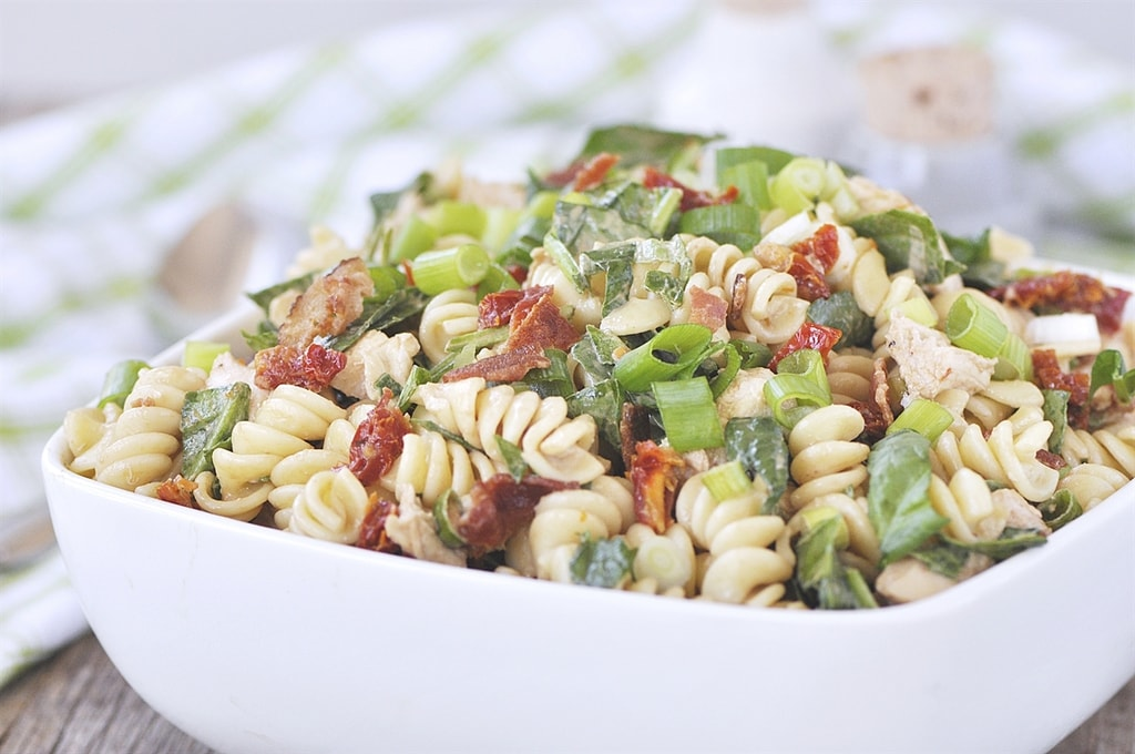 bowl of pasta salad with chicken bacon and sun dried tomatoe