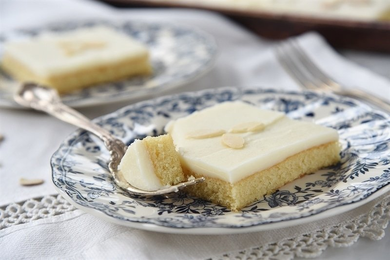 slice of white almond sheet cake