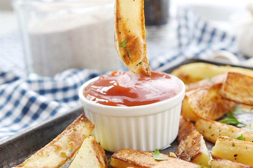 Garlic Fries dipped in ketchup