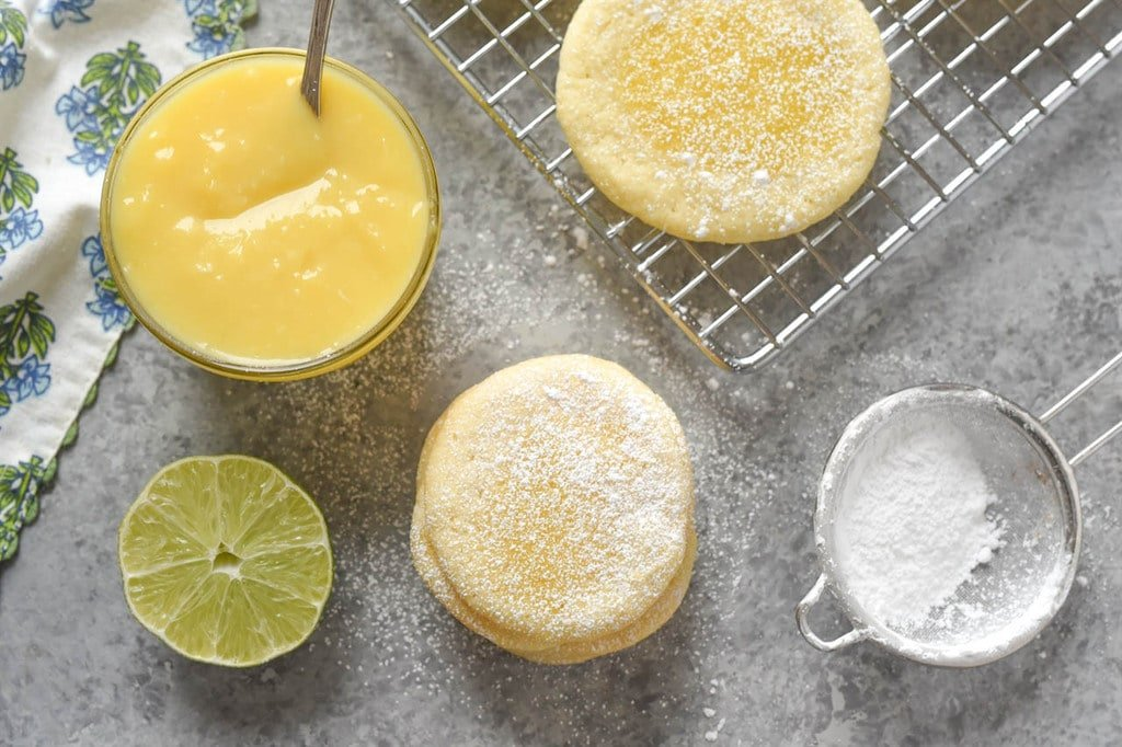 baked key lime cookies key lime curd and powdered sugar