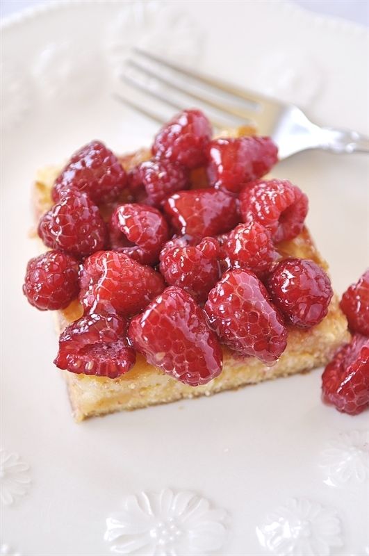 slice of Ooey Gooey Cake with Raspberries