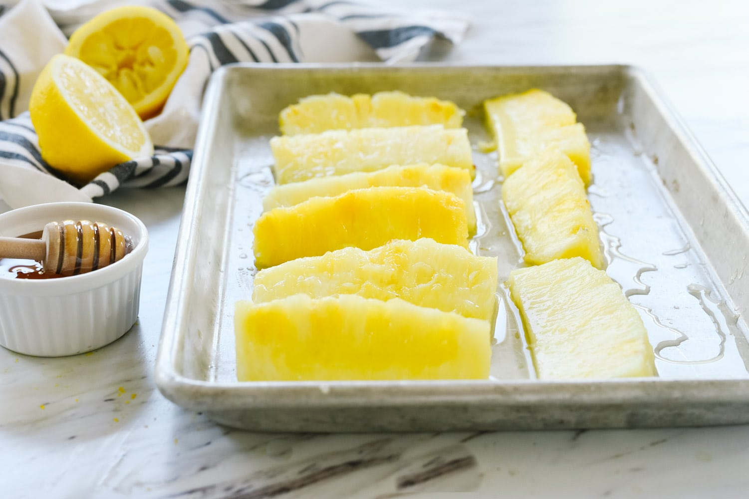Pineapple spears on a baking sheet