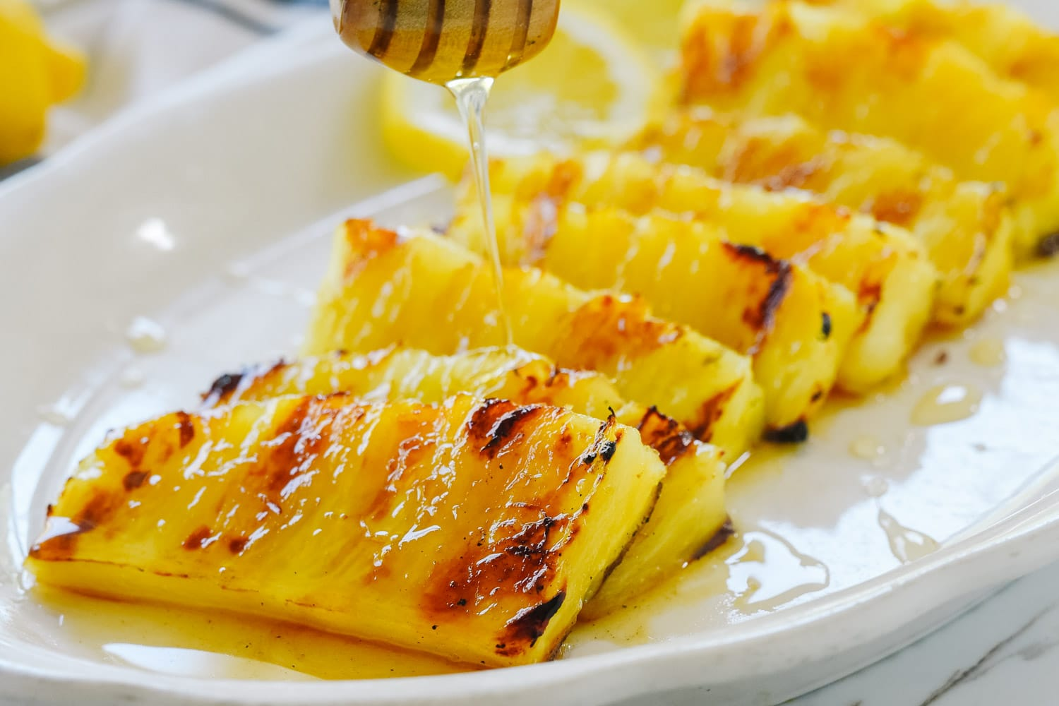 Drizzling honey on pineapple
