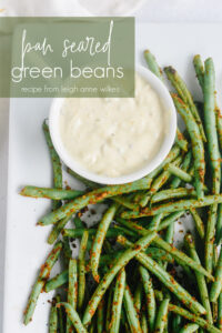 plate of green beans with dipping sauce