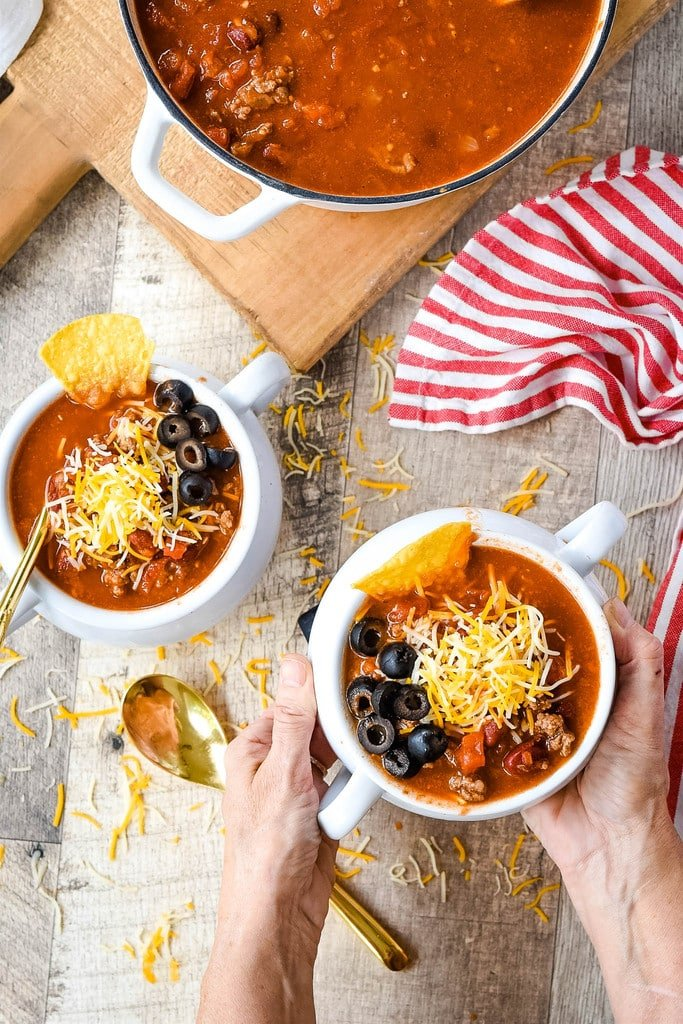 hands holding a bowl of taco soup