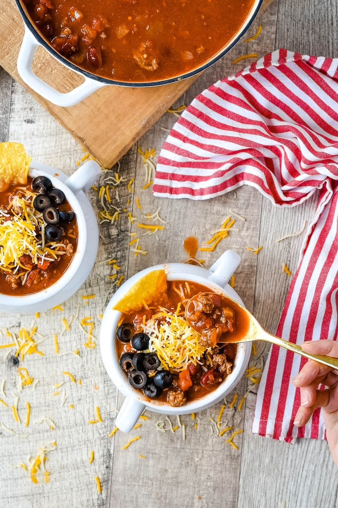 eating taco soup out of a bowl with a gold spoon