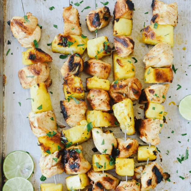 chicken pineapple skewers on a tray