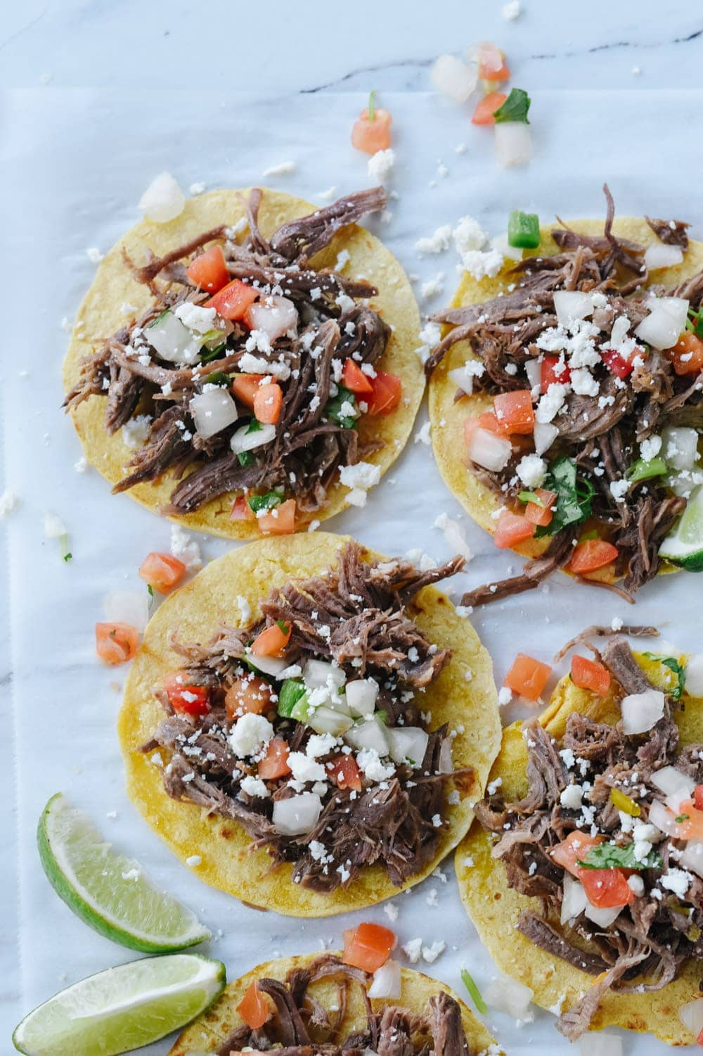 shredded beef tacos on corn tortillas