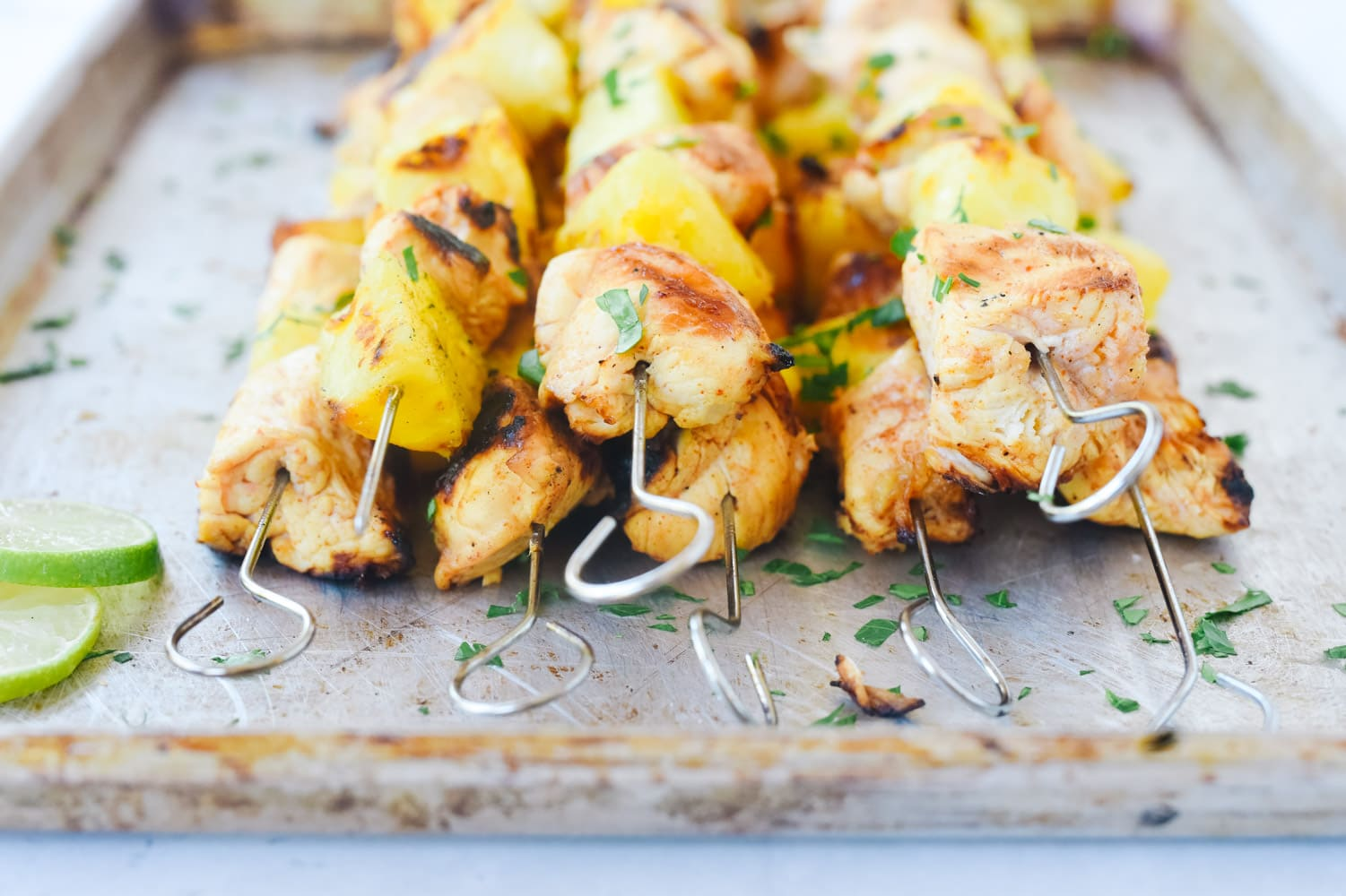 Chili Lime Pineapple Chicken Skewers on a tray