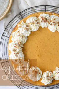 entire pumpkin cheesecake with whipped cream and pecans