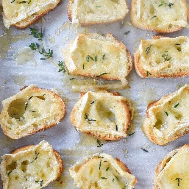 Slices of crostini with brie