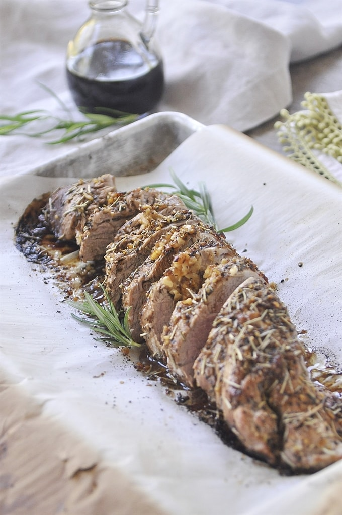 Balsamic Pork Tenderloin garnished with herbs