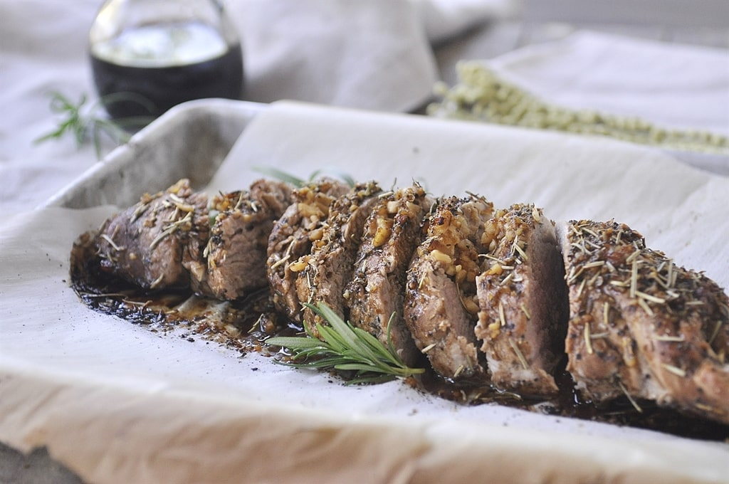 Balsamic Pork Tenderloin baked on a parchment covered baking sheet