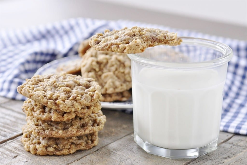 Oatmeal Toffee Cookie on a plate with milk