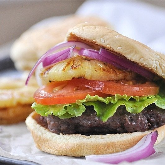 teriyaki burger with lettuce tomato onion and grilled pineapple