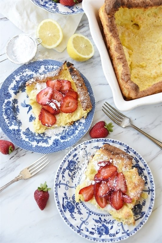 Sliced German Pancake swith strawberries and powdered sugar