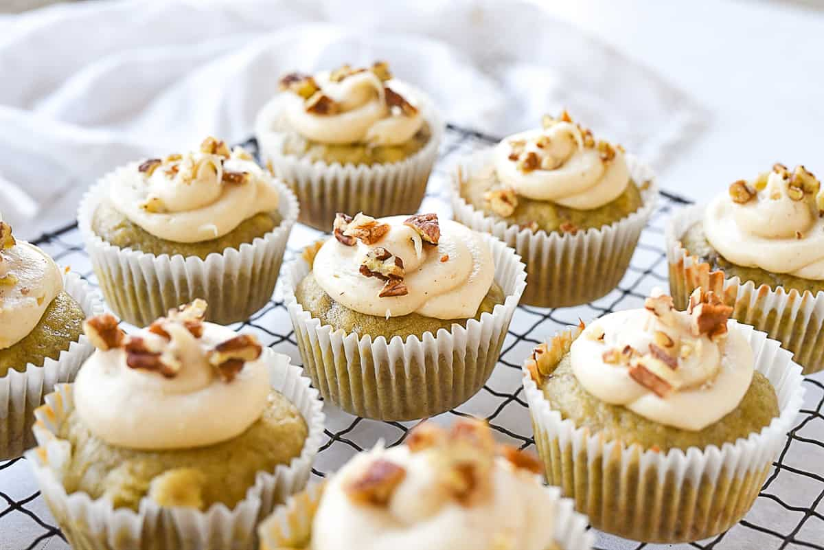 banana cupcakes with pecans on top