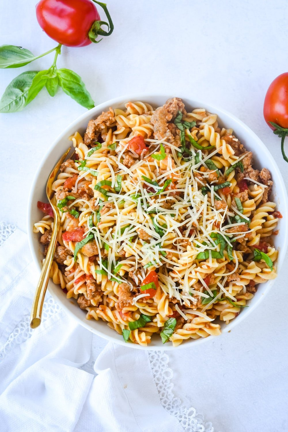 sausage and tomato pasta in a bowl