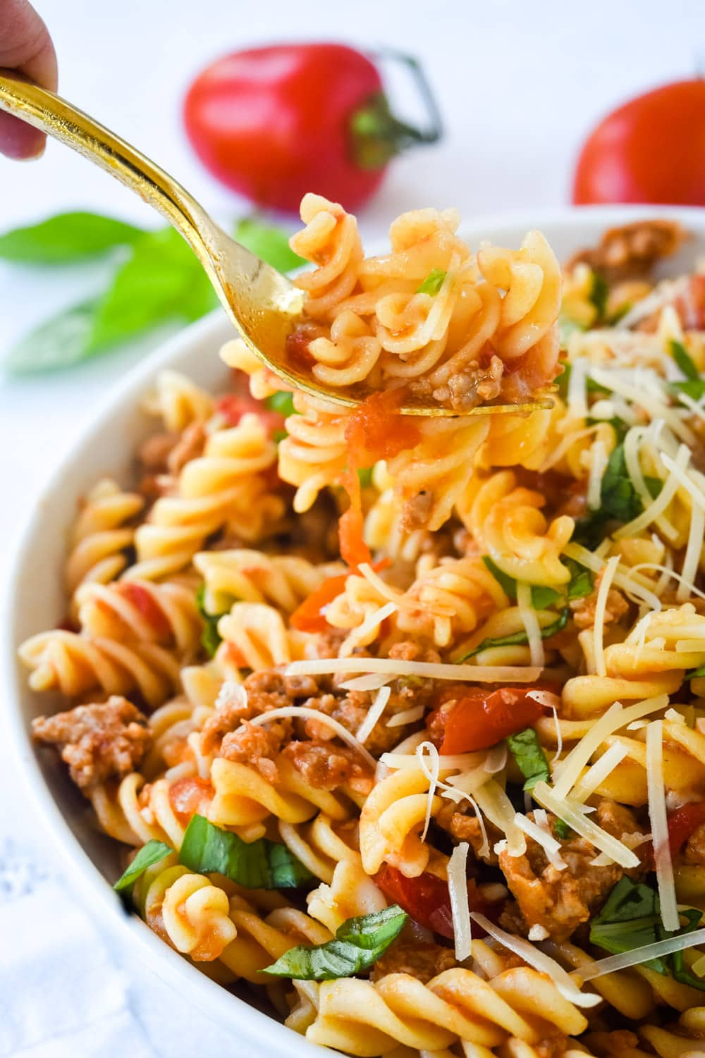 forkful of sausage and tomato pasta