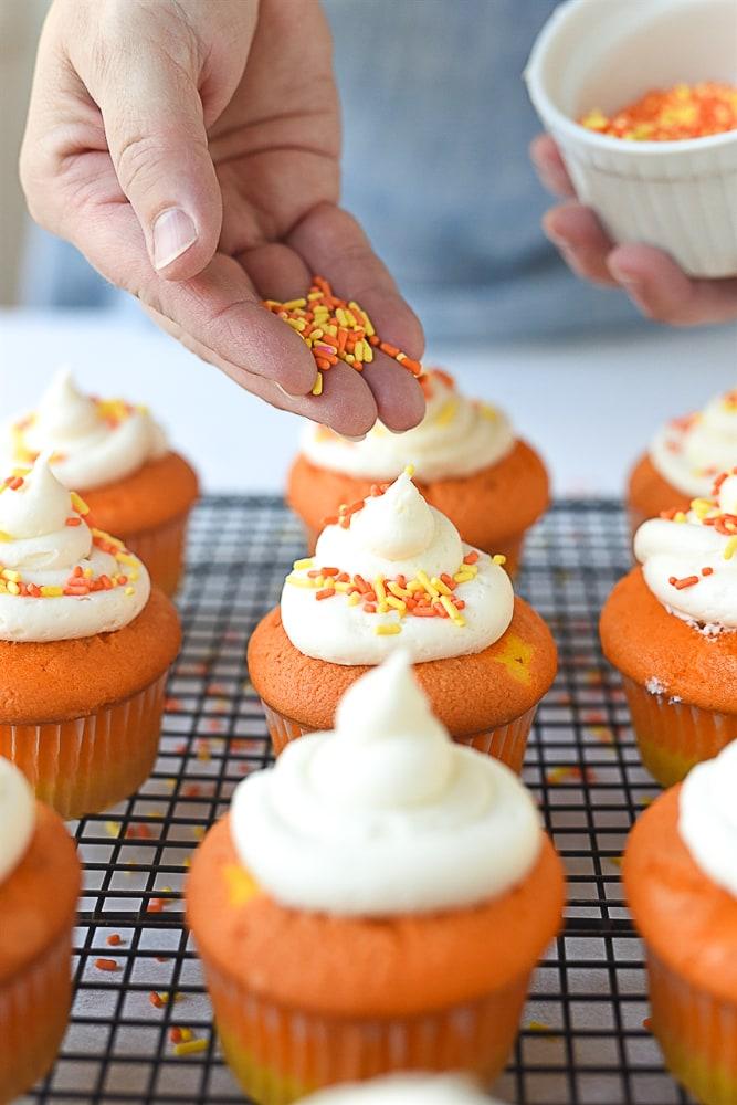 sprinkling cupcake with sprinkles
