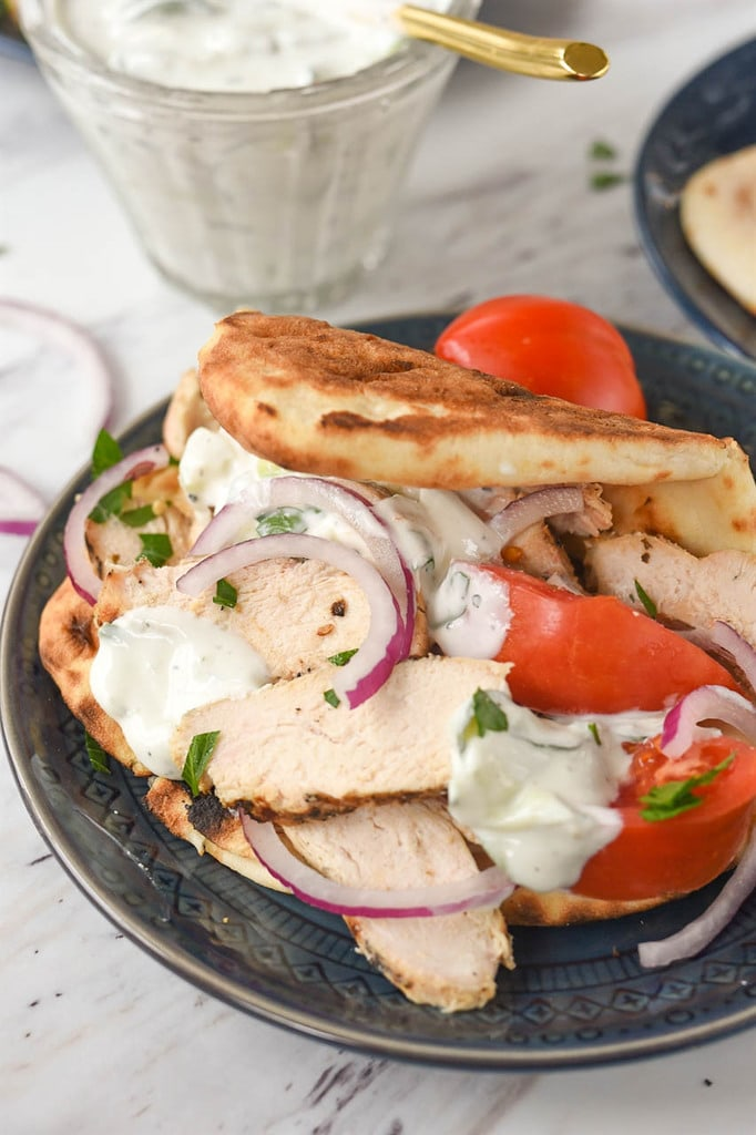Chicken Gyro with tomato onions and tzatziki sauce