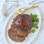sliced meat loaf on a white plate