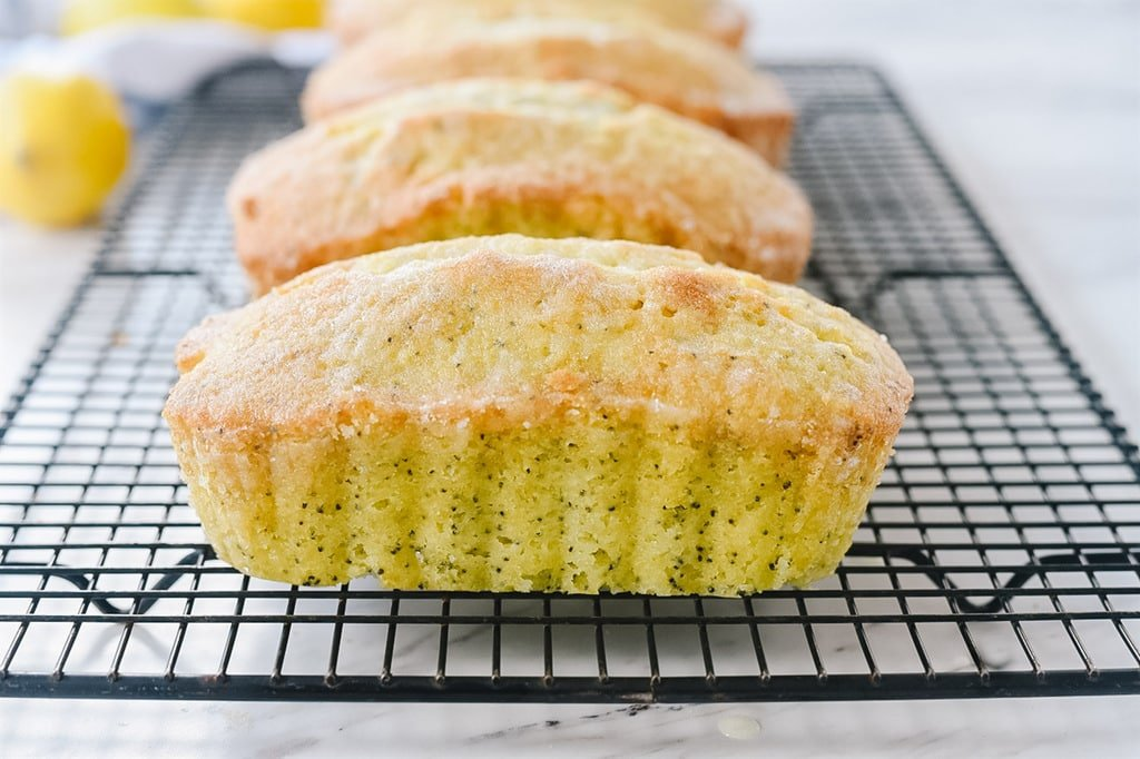 Lemon poppy seed bread on a cooling rack