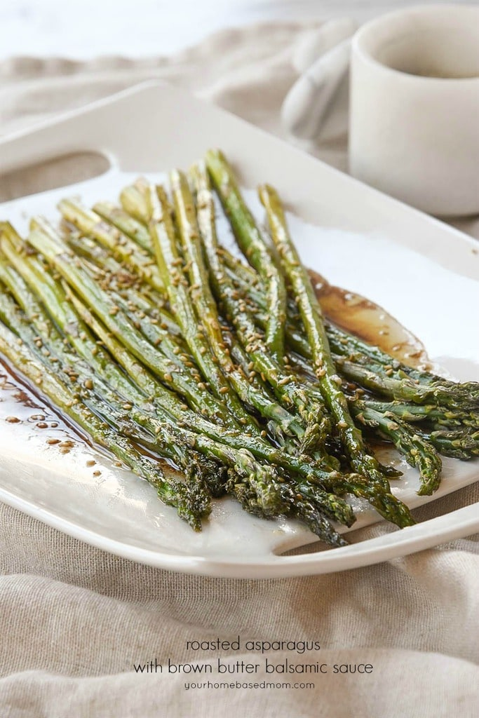 balsamic asparagus on a white serving tray