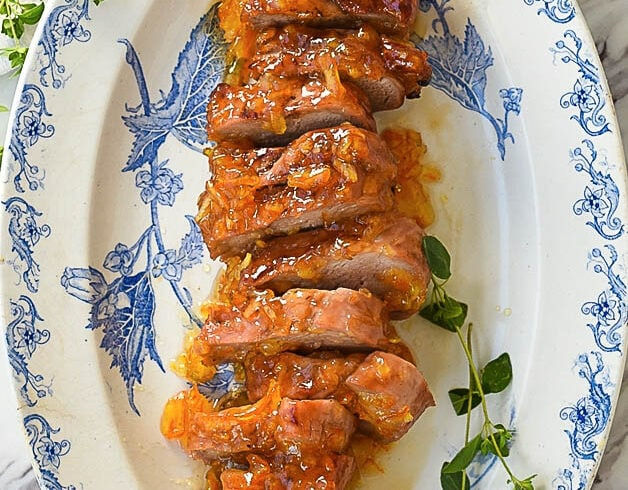 sliced pork tenderloin on a plate