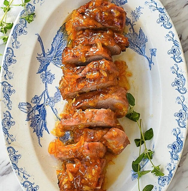 sliced pork tenderloin on a plate