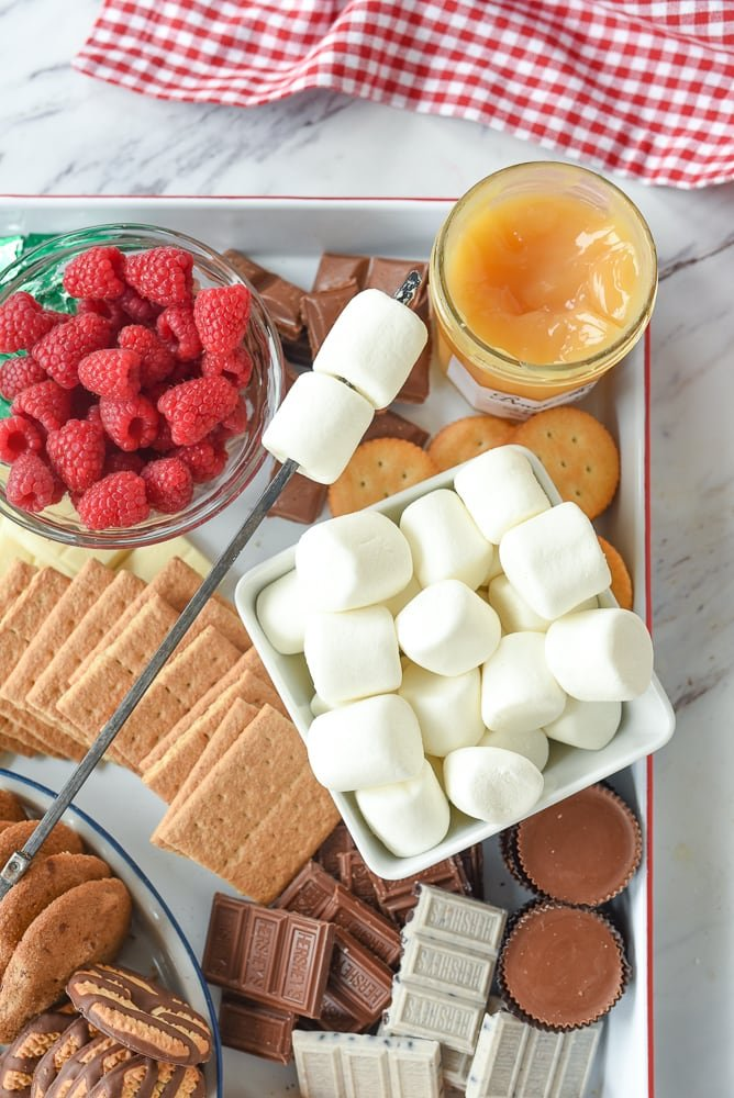 bowl of marshmallows and s'mores board