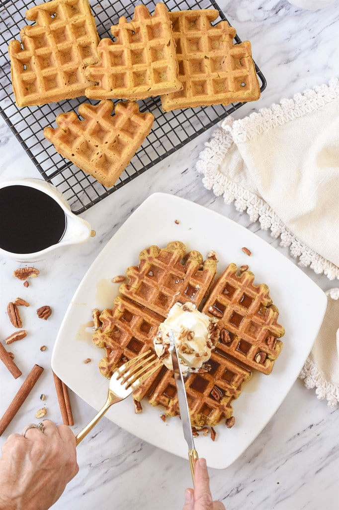 cutting into pumpkin waffles