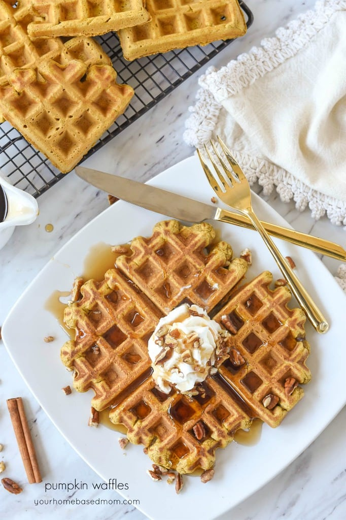 Pumpkin Waffles with whipped cream and pecans