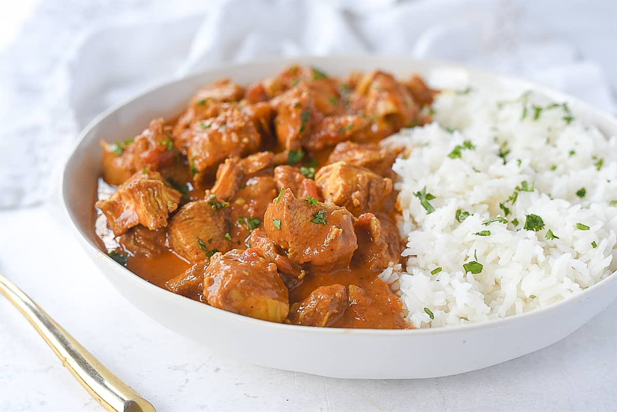 chicken tikka masala and rice in a bowl.