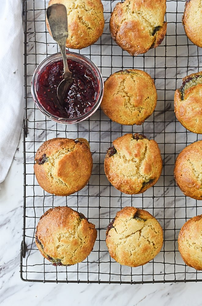 jam and muffins on a cooling rack