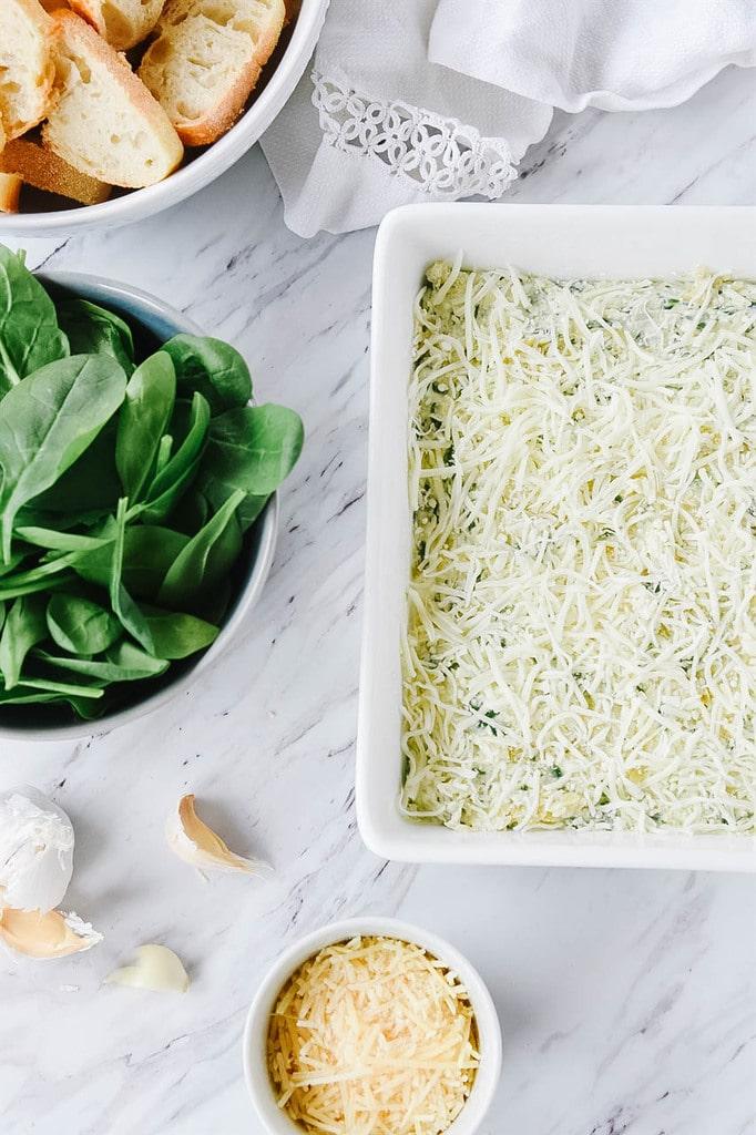 Spinach Artichoke Dip in a white dish