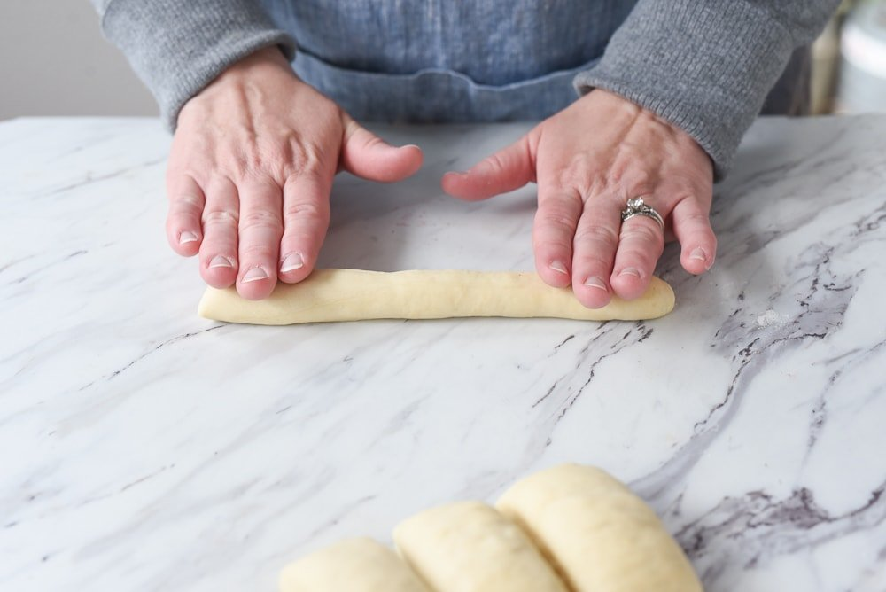 rolling out copycat olive garden bread sticks