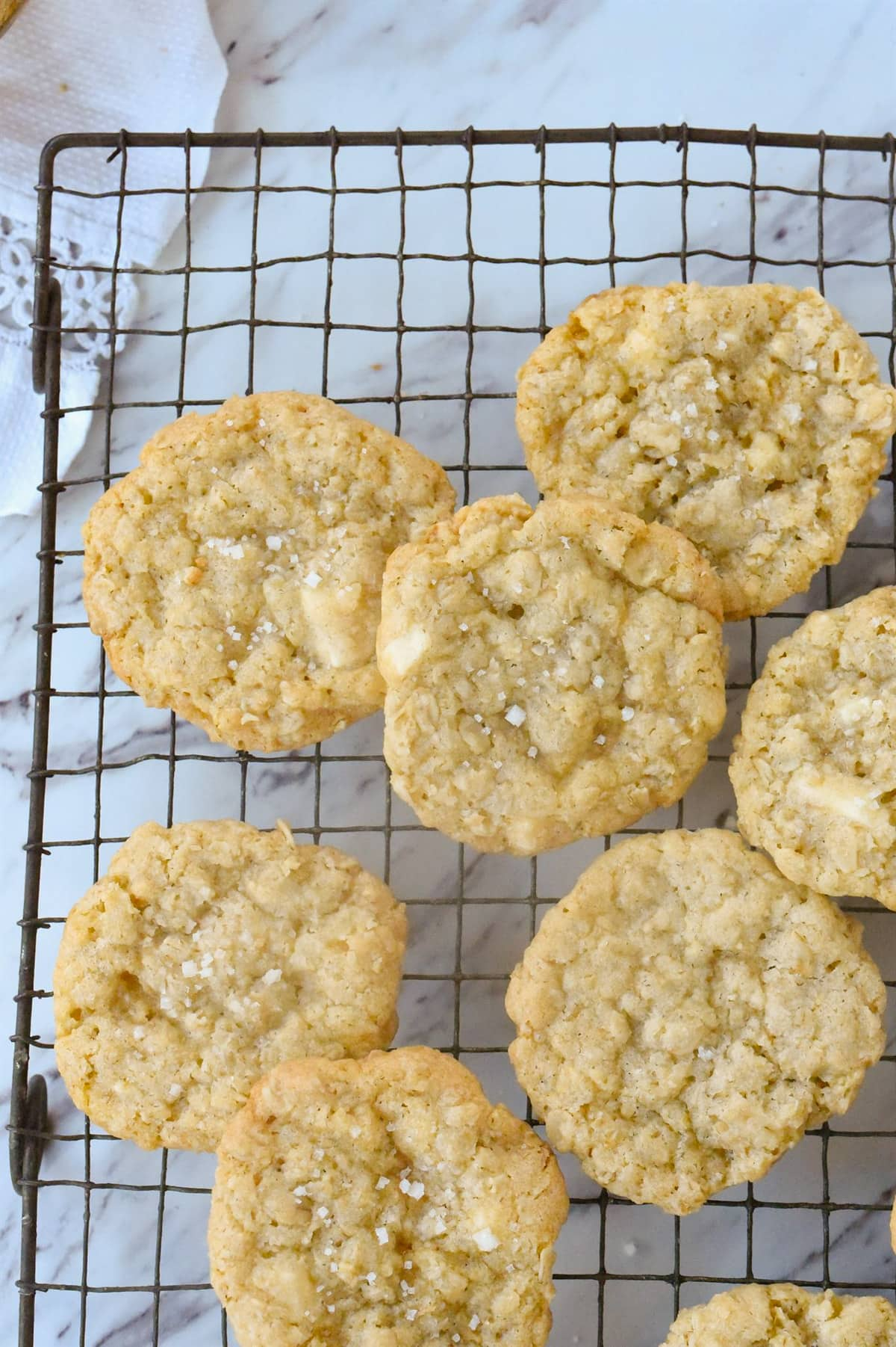 salted white chocolate chip cookies on a cooling rack