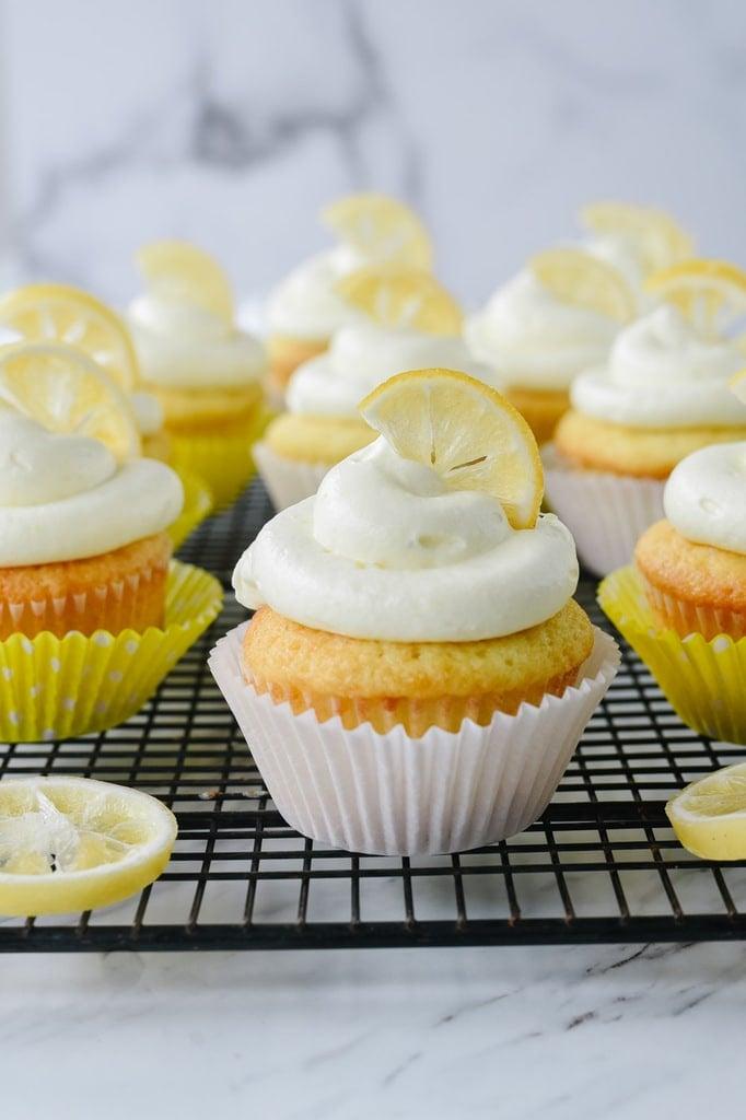 Lemon curd cupcake garnished with a lemon slice