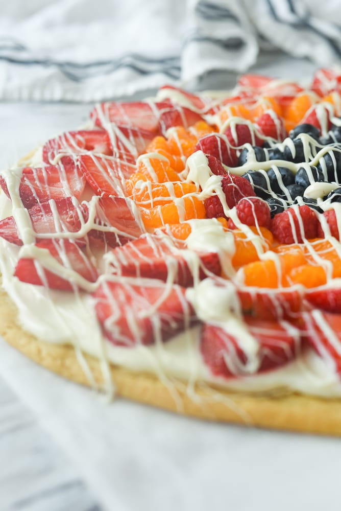 fruit pizza with white chocolate drizzle
