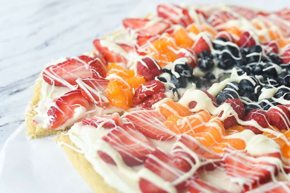 side view of a slice of fruit pizza