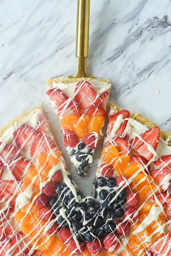 slice of fruit pizza on a spatula