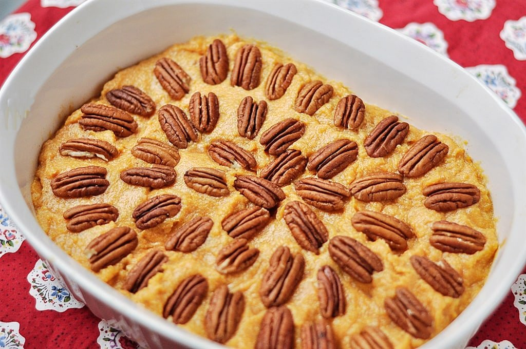 Pecan Topped Sweet Potatoes in a casserole dish