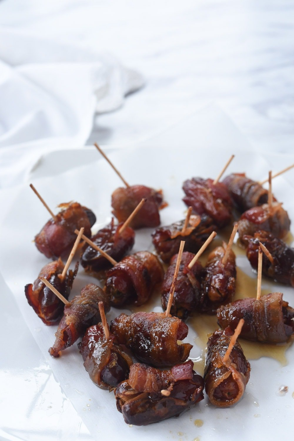 bacon wrapped dates with tooth picks