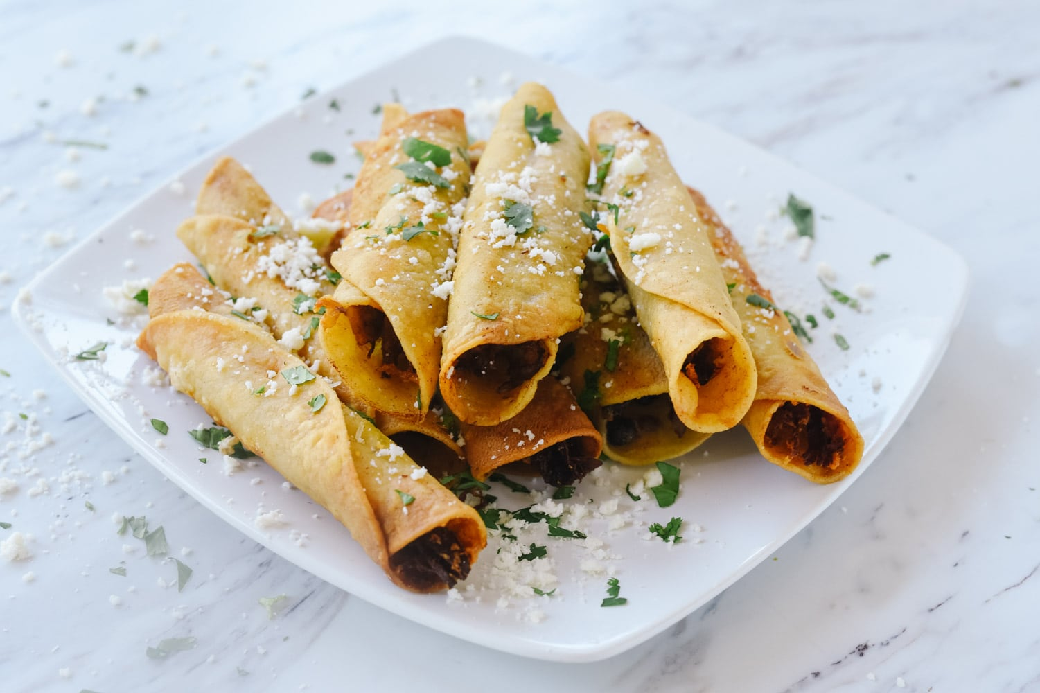 taquitos with cheese and cilantro