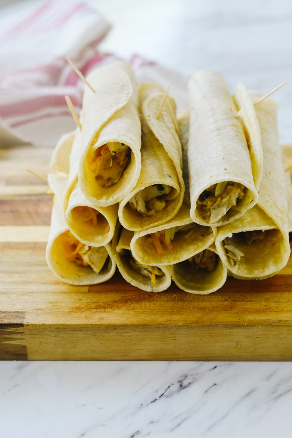rolled taquitos ready to cook