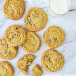 overhead shot of chocolate chip cookies and milk