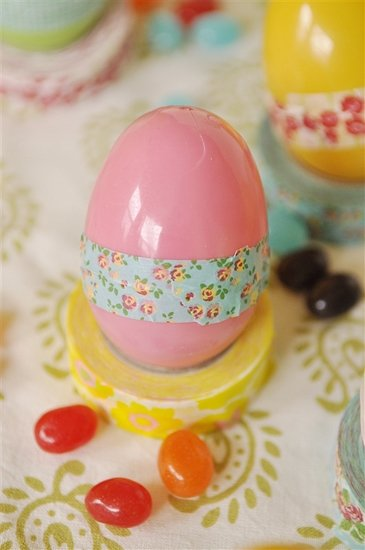 pink plastic easter egg with washi tape on it.